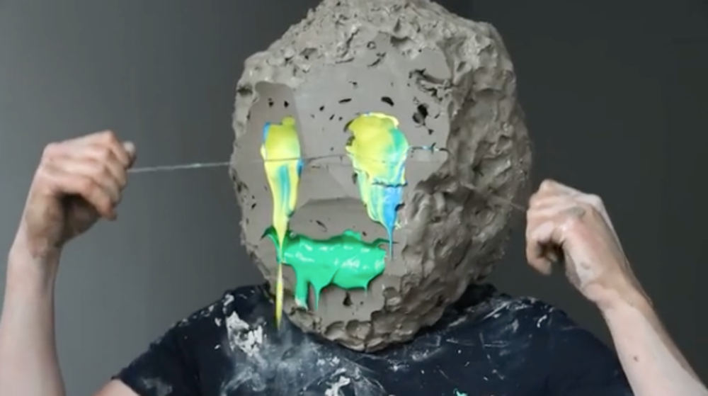 Okaaaay: Artist With Giant Clay Head Removing Slices With Wire Clay Cutter