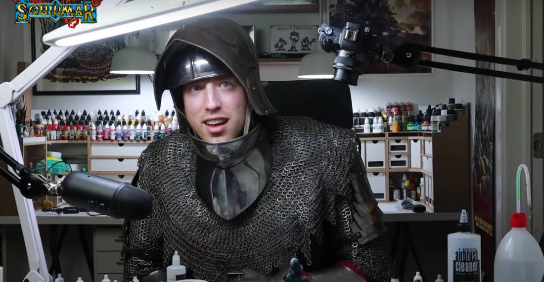 Miniatures Painter Paints A Knight Figure While Dressed As A Knight