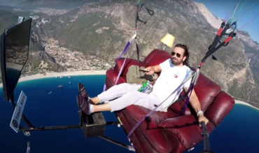 Lunatic Goes Paragliding On Couch Setup With Television