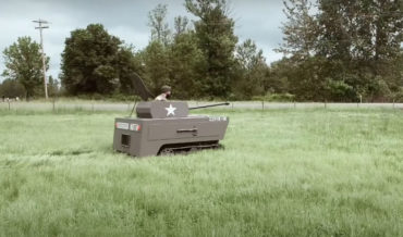 Guy Mods Ride-On Lawnmower Into Wooden Tank