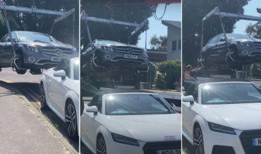 Tow Truck Crane Lifts Illegally Parked Car