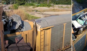 Low Bridge Opens The Top Of Auto-Carrying Rail Cars Like Sardine Cans, Destroying Cars Inside