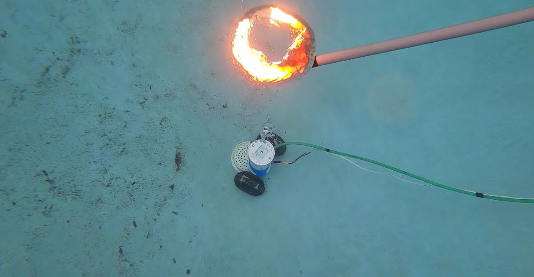 Count Me In: Igniting Gas-Filled Air Rings Underwater