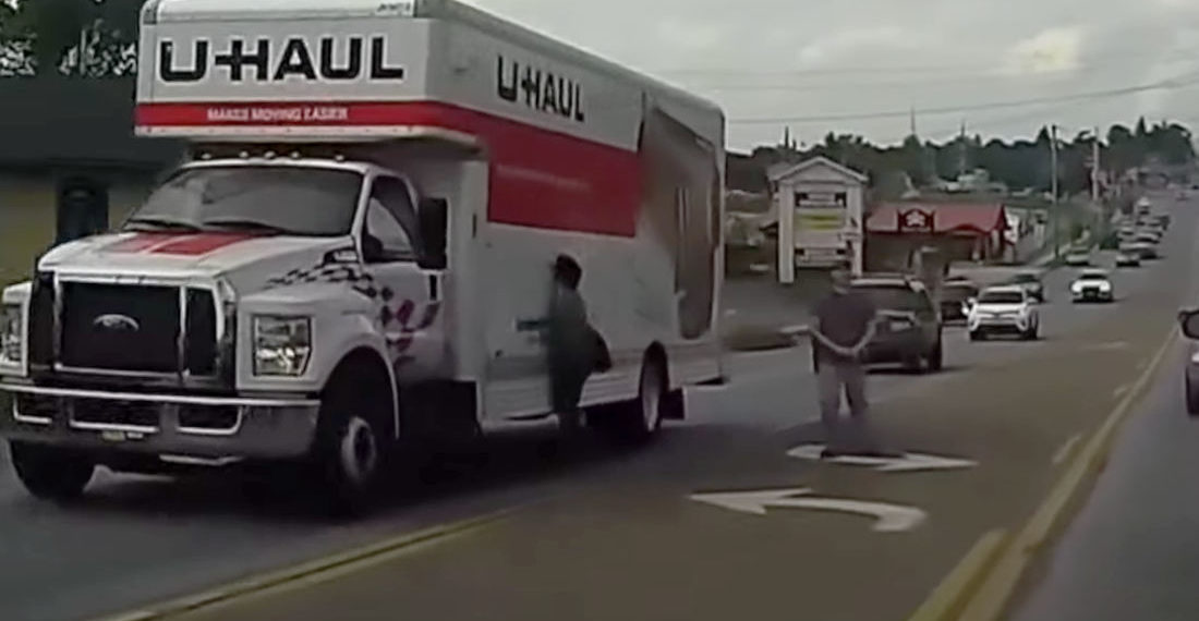 Jaywalking Lady Flipping Off Car For Honking Walks Right Into Side Of U-Haul