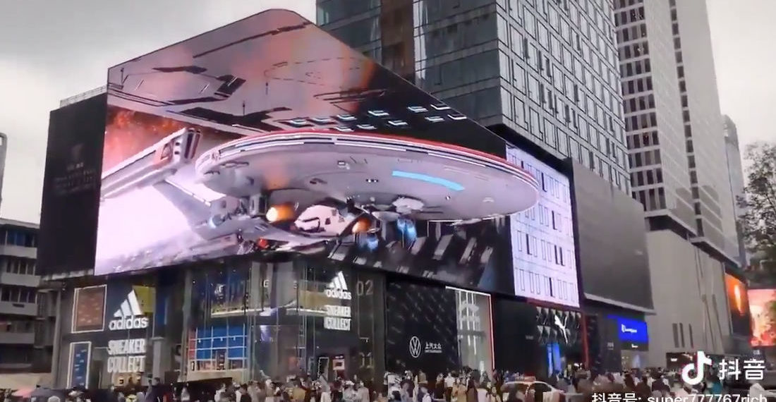 Whoa!: Massive Wrap-Around LED Billboard Creates 3-D Effect of Spaceship Docking