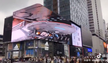 Whoa!: Massive Wrap-Around LED Billboard Creates 3-D Effect of Spaceship Docking