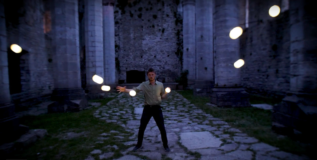 Oh Wow: This Guy's Hypnotic Glowing Ball Orbit Juggling Routine In An Old Castle
