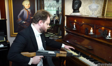 Pianist Performs Soviet Anthem With AK-47