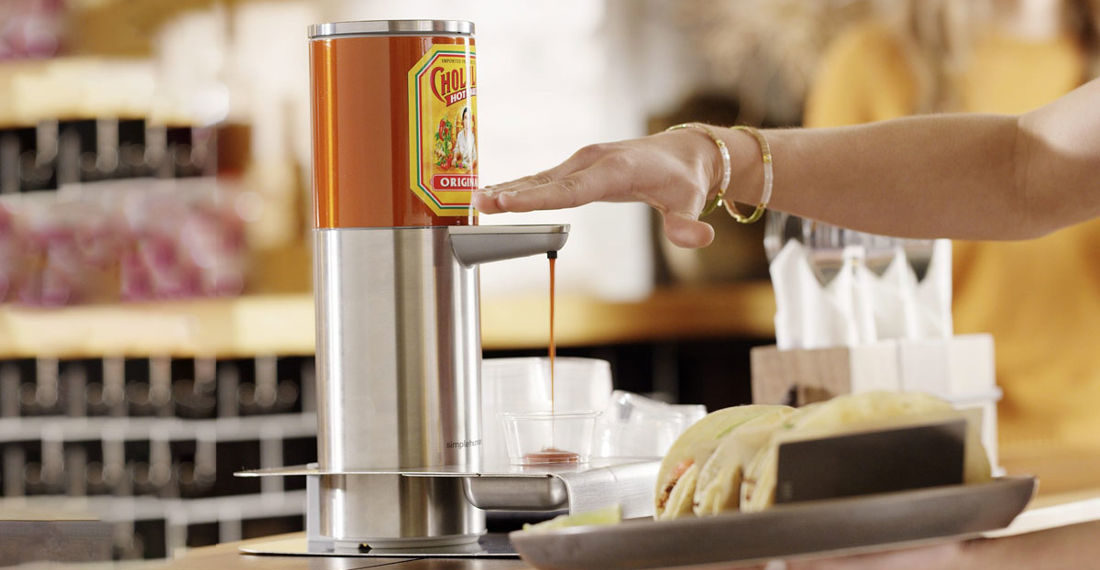 The Cholula Touch-Free Hot Sauce Dispenser