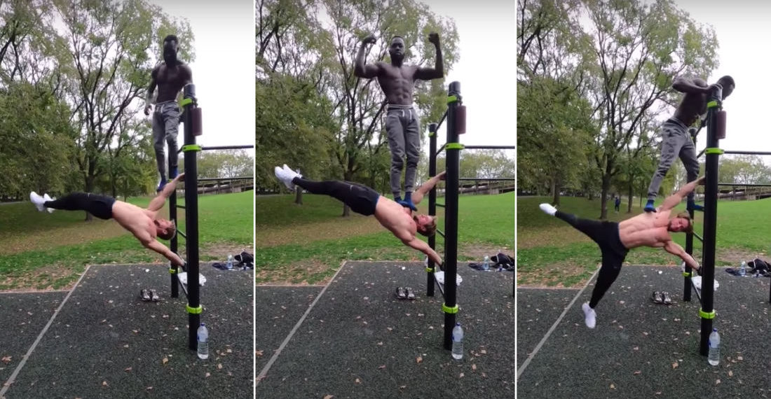 Bodybuilder Performs Human Flag With Another Guy Standing On Him
