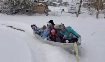 Sure, Why Not?: Kids Sledding In A Boat Pulled Behind ATV