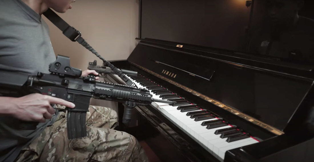 Performing The Star-Spangled Banner On Piano With An AR-15 And Pistol
