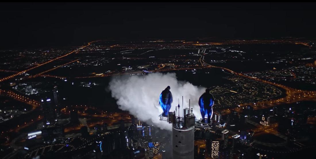 Wingsuit BASE Jumping From The Top Of Dubai's Burj Khalifa At Night