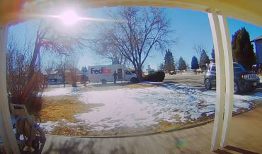 Doorbell Cam Captures FedEx Truck Being Stolen While Driver Delivers Package