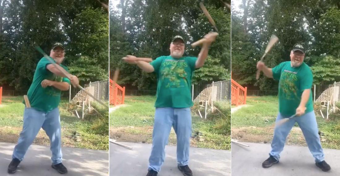 Older Ninja In TMNT Shirt Demonstrates His Bo Staff And Nunchuck Skills