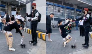 Guy Doing The Robot Tips Robotic Street Performer