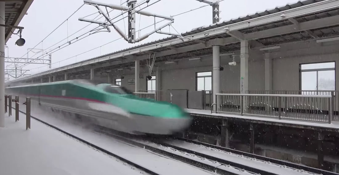 A Compilation of Bullet Trains Speeding By In The Snow
