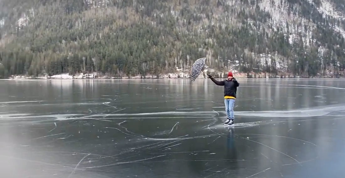 Ice Skater Uses Umbrella To Sail Across Frozen Lake Mary Poppins Style