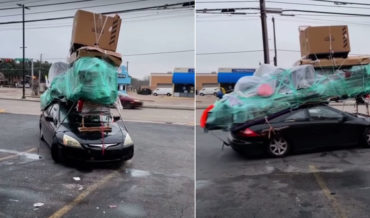 Car Loaded With Rooftop Of Stuff Bigger Than The Car Is