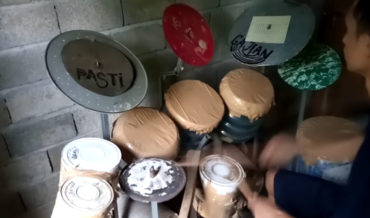 Drummer Performs Rush's 'Tom Sawyer' On Homemade Jug And Paint Can Drum Set