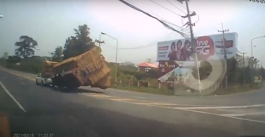 Womp Womp: Truck Overloaded With Hay Takes Turn Too Fast