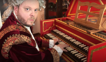 Mario Theme Performed By Man Dressed As Mozart Playing Baroque Harpsichord