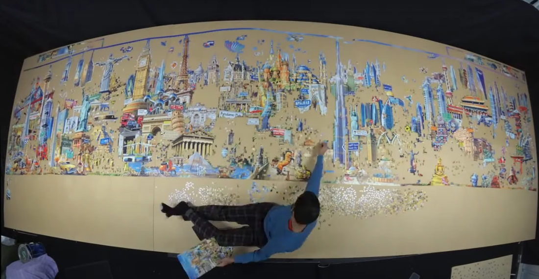 Timelapse Of Man Assembling A Giant 42,000-Piece Puzzle Of World Landmarks