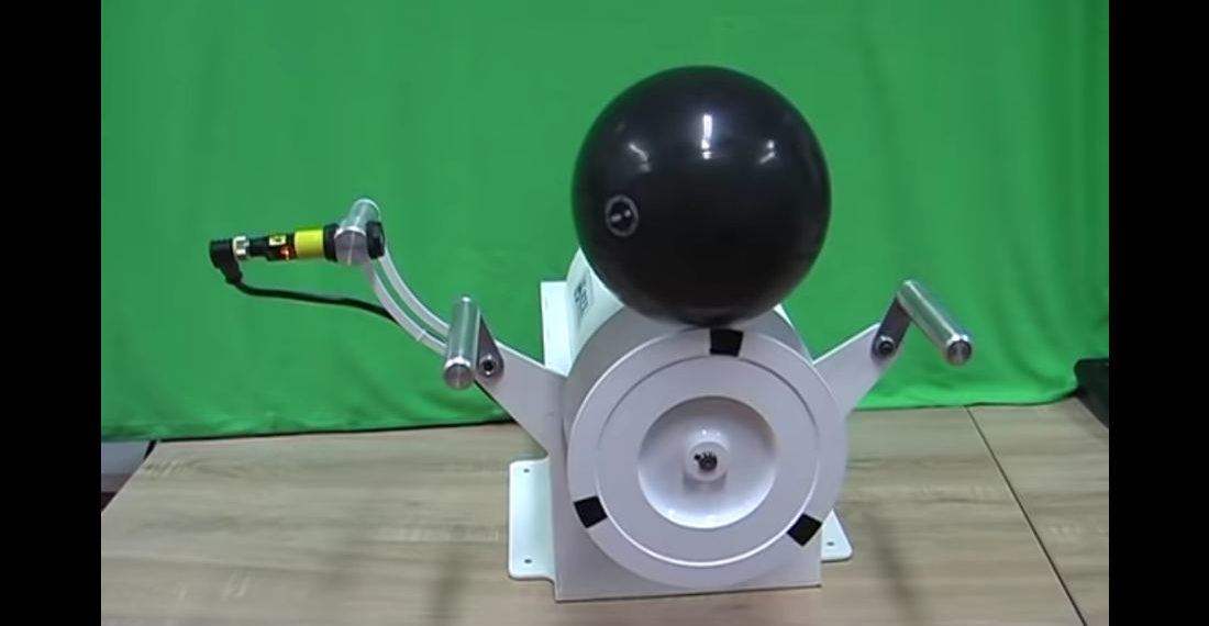 Machine Balances Bowling Ball On Rotating Spool