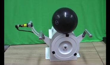 Machine Balances Bowling Ball On Rotating Spool