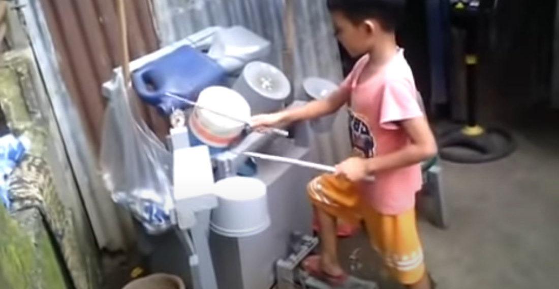 Kid Covers Guns N' Roses On Homemade Bucket And Jug Drum Set