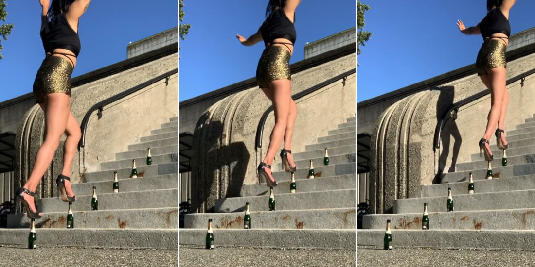 Woman In High Heels Walks Up Stairs Balancing On Bottle Tops