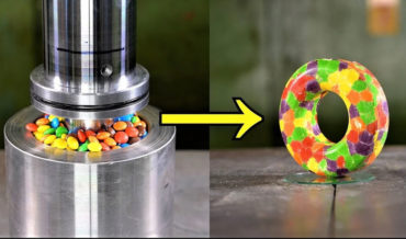 Using A 150-Ton Hydraulic Press To Mold M&Ms And Skittles Into Donuts
