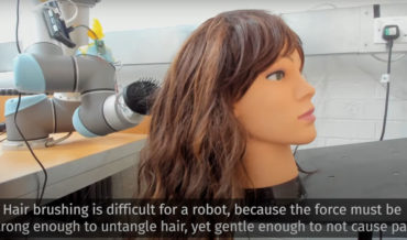 Teaching A Robot To Brush Tangled Human Hair Without Causing Pain