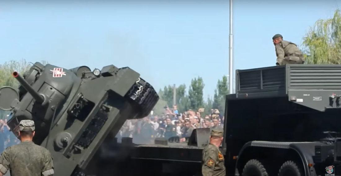 Tank Rolls Off Transport Truck During Parade
