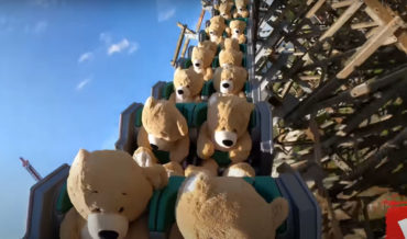 Watching A Roller Coaster Filled With Giant Stuffed Teddy Bears