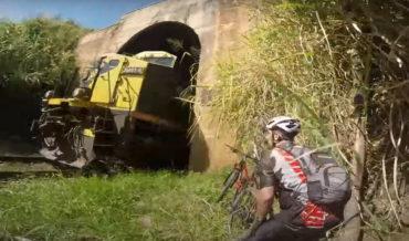 Cyclists Taking Shortcut Through Train Tunnel Almost Meet Train