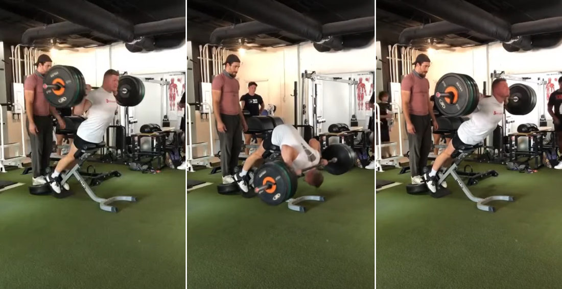 Man Performs Extremely Heavy Weight Back Extensions