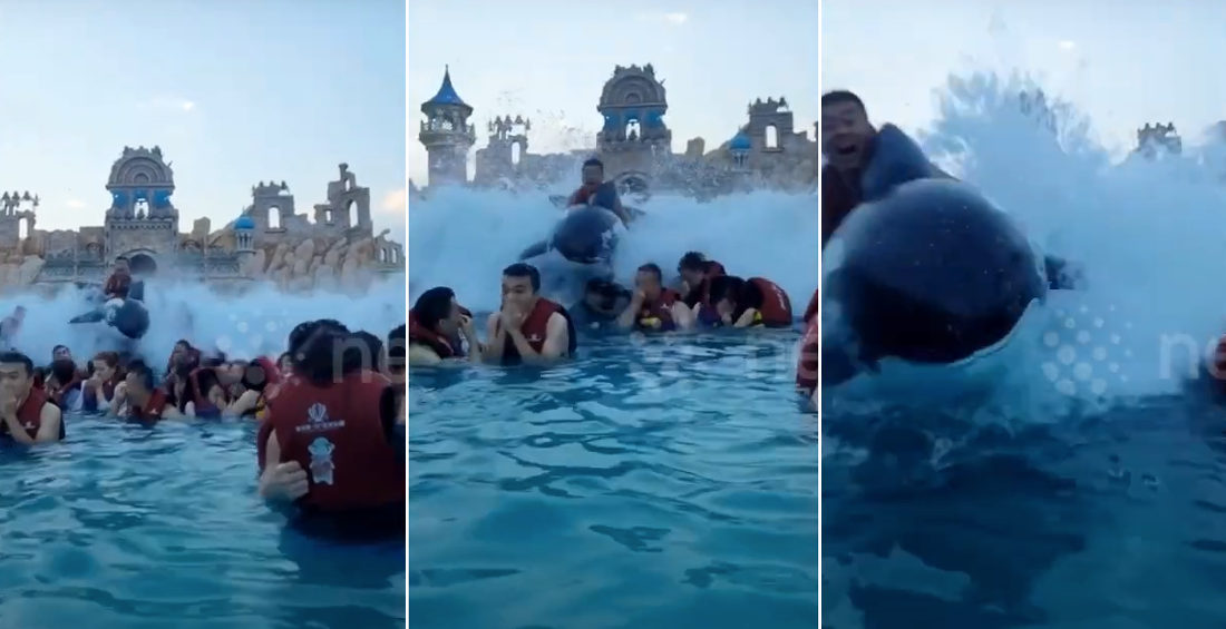Man Riding Inflatable Orca Surfs Over Other Swimmers In Wave Pool