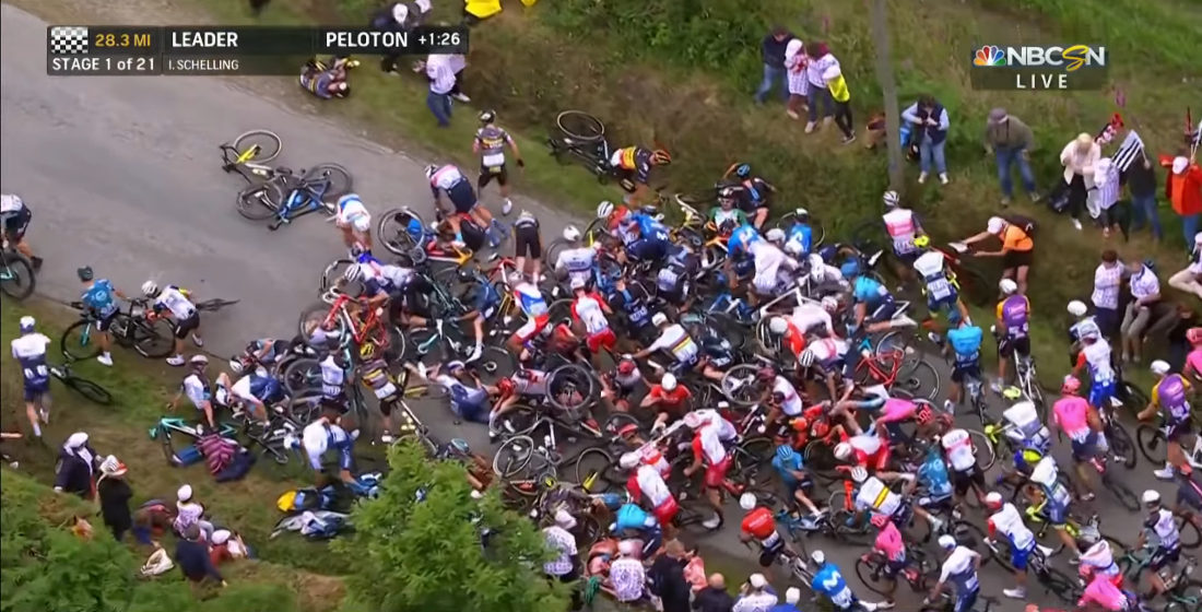 Oblivious Sign-Holder Causes Massive Crash At Tour de France