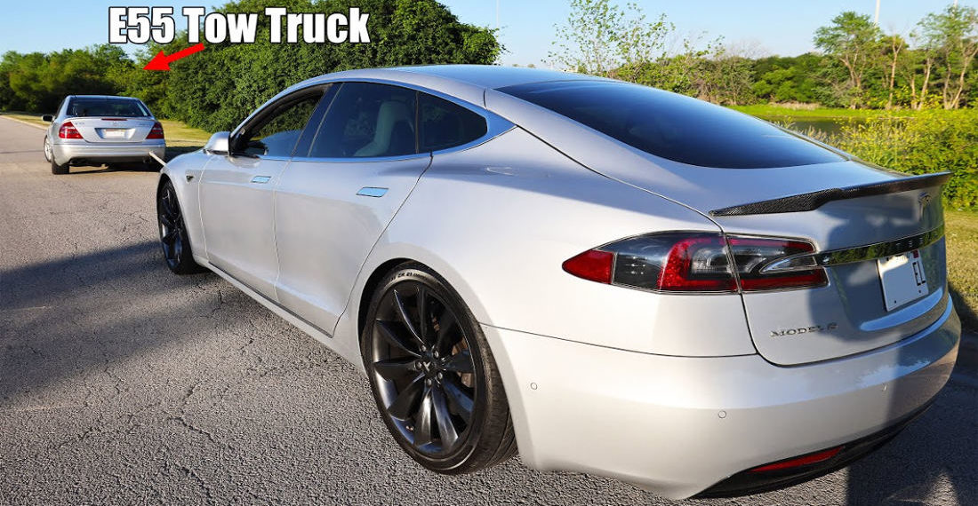 Man Quick Charges Tesla By Being Towed On Highway At 70MPH