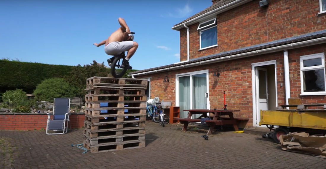 Unicyclist Makes Incredible 10-Pallet High Jump