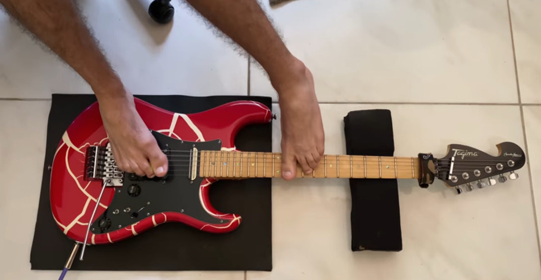 Musician Performs Guns N' Roses' 'Sweet Child O' Mine' On Electric Guitar With Feet