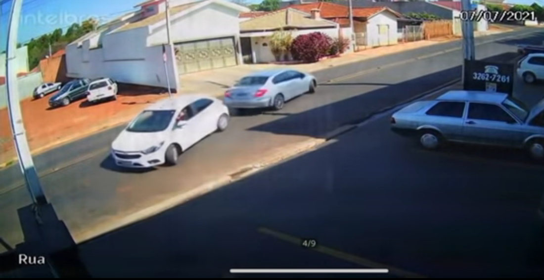 Two Cars Across The Street From Each Other Reverse Into Road At The Same Time