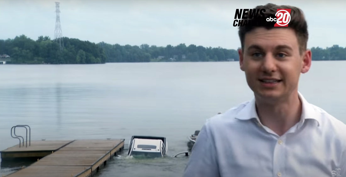 Truck Sinks Behind News Reporter At Lake