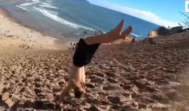 Holy Smokes: Man Performs Endless Backflips Down Steep Sand Bank