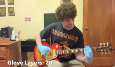 Playing Metallica's 'Enter Sandman' Wearing More And More Layers Of Latex Gloves