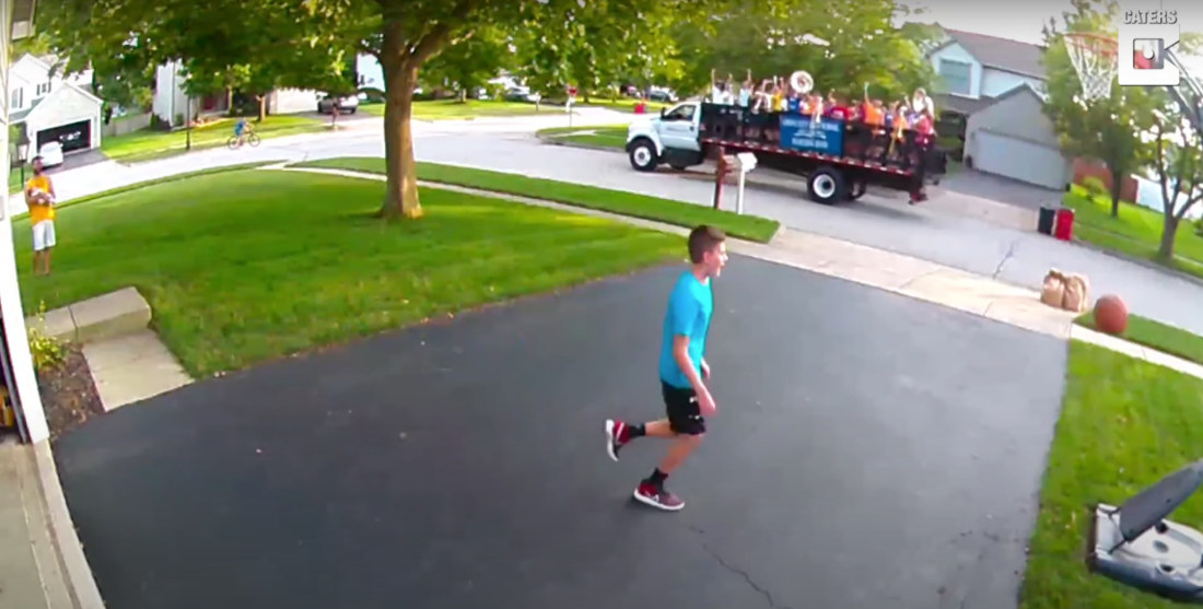 Kid Shooting Hoops In Driveway Sinks Shot, Passing Marching Band Plays Him Off